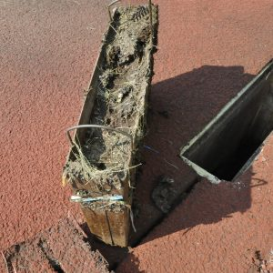 Track drain cleanout basket