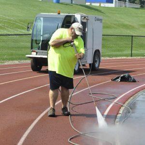 Pressure washing track